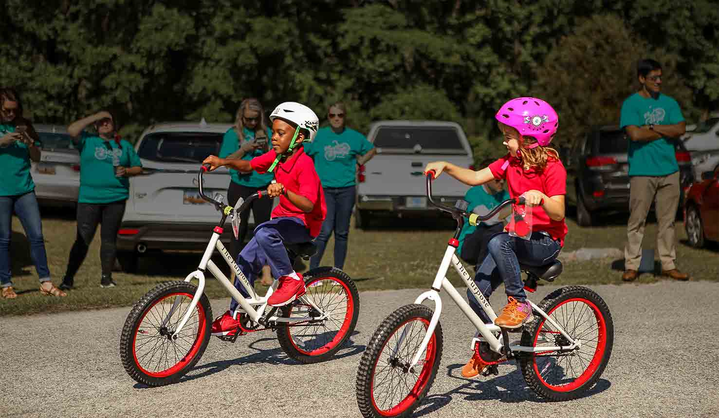 """Featured image for """"Fathom and Going Places Nonprofit Surprised Students With Free Custom Bikes"""""""
